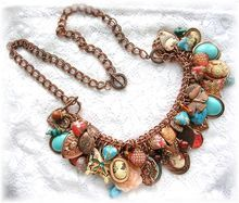 Vintage Cameo Heart Charm Bracelet Necklace Butterflies Copper Aqua Coral Glass Beads Flowers from The Vintage Heart on Ruby Lane