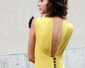 Gorgeous, partially backless yellow dress. Perfect with black gloves