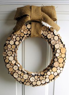 winter wreath hand-crafted with wood slices. choose a burlap bow or something more glitz-y for decoration - make with wine corks Wreath Crafts, Diy Wreath, Cork Wreath, Wreath Ideas, Stick Wreath, Burlap Wreath, Wreath Fall, Burlap Ribbon, Ribbon Bows