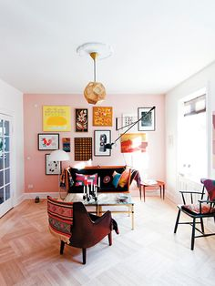 265 wall lighting fixture from FLOS in this colorful, creative and inspiring living room.