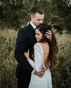Hold me tight and don't ever let me go ✨Love this open back lace gown! This super sweet moment captured by @rachellynn_photo & @alex.modisette ✨ Tag someone you know who would love this and makes you smile! More dresses on our site, link in bio. . . . #weddingdress #weddinghair #photography #hair #hairstyles #inspiration #bridetobe #bride #love #weddinggown #weddinginspiration #beauty #details #florals #flowers #cute #WDOfficial #weddingday #engagementshoot #beautiful #wedding #dress…