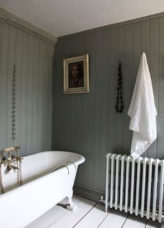 tongue and grove panelling with free-standing bath and reproduction radiator