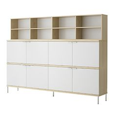 Woodstock - Storage - Office furniture - Kinnarps  Cabinet and upper shelving in birch or oak veneer movable shelves. 416 cabinet with doors in birch, oak or white lacquer, magnetic locks as accessories.