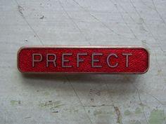 A Vintage School 'Prefect' Badge/Pin - Red Enamel Circa 1940's. by TownshendsEmporium on Etsy
