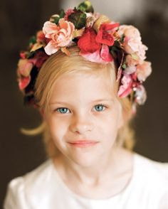 Bill's five-year-old niece wore a crown of millinery roses and leaves to fulfill her flower girl duties.