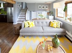 Gray and yellow living room seems both cozy and contemporary