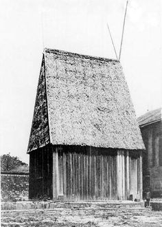 The Besakana, a structure in the Rova palace complex, is representative of the traditional wooden aristocratic dwellings of the Highlands of Madagascar. Note the long tandrotrano extending past the roofline.