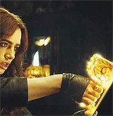 CLARY PULLS THE MORTAL CUP OUT OF THE TAROT CARD
