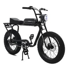 The world's coolest ebike. The is a high performance, long range-electric motorbike. With no license or registration needed, this bike has an average battery range of for the charge. Ride comfortably at and safely with our fat tires. Motorcycle Camping, Camping Gear, Scrambler Motorcycle, Cargo Rack, Off Road Tires, Power Bike, Bike Parking, All Terrain Tyres, Bike Accessories
