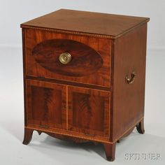 Mahogany Inlaid Night Cabinet, probably Massachusetts, c. 1805-15, with hinged top, the front with an oval within a mitered panel above two faux doors with crossbanded borders on flaring French feet, refinished, (lacks interior), ht. 26 3/4, wd. 21 3/4, dp. 18 3/4 in.