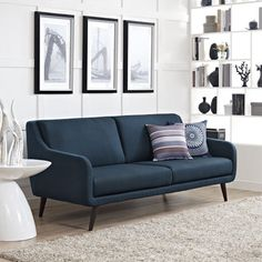 Take a break and enjoy the plush elegance of this Modway Verve sofa. The charming mid-century feel of this sofa is enhanced by the simplistic design and espresso-stained rubberwood legs. This large so