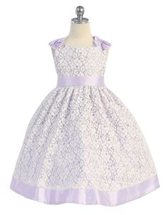 Classic style with trendy flare. Sleeveless lace dress features adorable shoulder bows that match both the waist sash and hem of dress, $69.99
