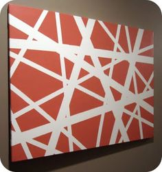 made by having painters tape on a canvas and then painting it!  Cheap and creative!