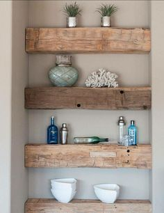 Recycled old beams made into wall shelving