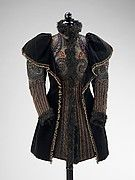 Emile Pingat had a proclivity for designing carefully finished dresses and outerwear which made him one of the top three French fashion designers during the second half of the 19th century.  Active between 1860 and 1896, Pingat was adroit at manipulating multiple textiles and trimmings into a cohesive and elevated garment