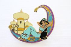 This beautiful rare Disney pin for sale features Princess Jasmine from Aladdin laying back on her glittery Magic Carpet with the Sultan's Palace Castle in the background, very pretty from the Borders