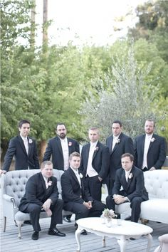 black suit groomsmen will go great with the blush