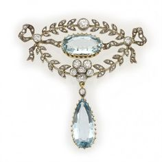 A late Victorian aquamarine and diamond brooch, the brooch set with an oval-shaped faceted aquamarine, set to the centre of a delicate open diamond surround of laurel garlands, ribbon ties and foliate motifs, suspending a pear-shaped aquamarine drop, the yellow gold-set aquamarines estimated to weigh a total of 6.8 carats, the diamonds estimated to weigh a total of 1.3 carats, all set in silver to a yellow gold mount, with detachable necklace and brooch fitting, gross weight 19 grams, circa…