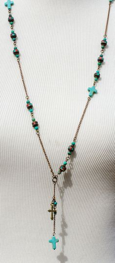 $75.00 Tibet beads inlaid with turquoise & coral, natural brass, turquoise, Howlite, African heshi and brass cross charm....debi lynn designs  Owned and worn by Ms. Reba!