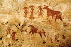 Neolithic rock art, Chad, representing women with cows and a calf. Red ochre natural pigment.