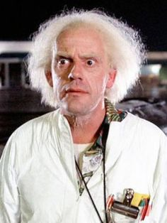 Christopher Lloyd as Dr. Emmett Lathrop Brown in Back to the Future. Marty Mcfly, No Seas Mamon, Iconic Movie Characters, History Of Time, Doc Brown, Bttf, Back To The Future, This Man, Movies