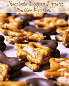 Chocolate Dipped Peanut Butter Pretzels ~ Delicious peanut butter stuffed between two pretzels and dipped in chocolate!