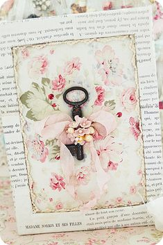 We love shabby chic - pretty card with key, ribbon and old book paper...