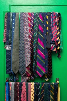 """Inside the closet of Menswear Designer Fred Castleberry: Wall of ties. """"I pass style stuff onto my sons—they're starting to get interested in clothes and how they look. They go to a private school where they wear a uniform, so they're already starting to become bitter about that. They're kicking against it by really getting into streetwear and skater clothing. Which is cool, because I love both of those things. It's a cool intersection between sportswear and tailored clothing.""""…"""