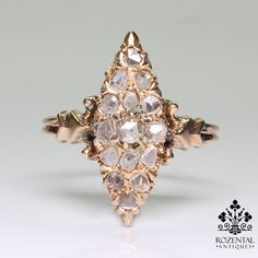 Period: Victorian (1836-1901) Composition: 18K gold. Stones: - 15 Rose cut diamonds of I-SI2quality that weigh 0.50ctw. Ring size: 8 ½ Ring Face: 21mm by 8mm Rise above finger: 6mm. Total weight: 3.7g