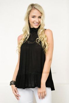 Stay elegant in this midnight black top. The sleeveless top features a mock neck, a ruffled hem, a keyhole back, and a top lace sheer front. Add accessories to glamorize this lovely top! Model is 5'5""