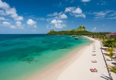 Beautiful beach at Sandals Grande St Lucian; an all-inclusive adults only honeymoon resort on the Caribbean island of St Lucia.