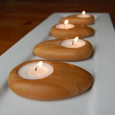 Wooden Pebble Tea Lights made from organic bamboo. 4 for $15 at www.re-modern.com