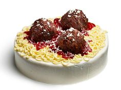 """Spaghetti-and-Meatball Cake : Chocolate cake """"meatballs,"""" piped yellow frosting noodles, homemade strawberry sauce and grated white chocolate """"tomato sauce and Parmesan"""" make this after-dinner treat look exactly like the real meal. Cake Recipes, Dessert Recipes, Desserts, Pasta Recipes, Kid Recipes, Dishes Recipes, Jewish Recipes, Food Network Recipes, Food Processor Recipes"""