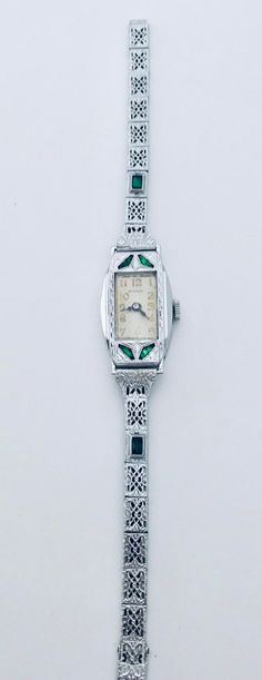 """Antique Art Deco Bulova ladies wristwatch named the """"Justine"""". Has a 17 jewel mechanical wind movement, original dust protector, and white gold filled filigree case/band. Antique Art, Rare Antique, Art Deco Watch, Steam Punk Jewelry, Antique Watches, Bulova, Beautiful Watches, Flower Fashion, A 17"""