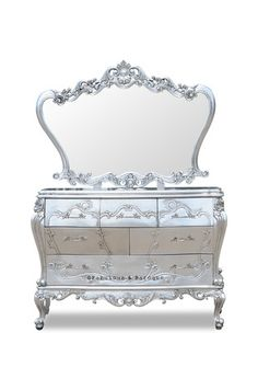 This stunning Angelique dresser mirror is scalloped and intricately carved edges, delicately frame the mirror, while the brilliant silver glaze dazzles the eye. This curvy beauty is paired wonderfully with the Angelique Dresser. The only thing more beautiful than the handcrafted and scrolled frame is your image reflected in the mirror! #Fabulous&Baroque