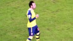 Santi Cazorla celebrates assist to Giroud's header v Man City