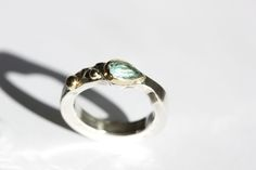 silver ring, gold and blue topaz