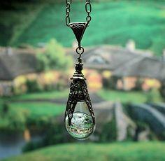 "Hobbit inspired pendant  ""Arkenstone"" ""Heart of the mountain"" Crystal orb, Bronze filigree wire wrap, quartz crystal encased in molten glass. $32.95, via Etsy."