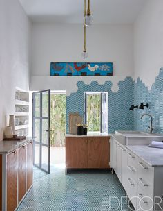 Beautiful Floor and kitchen design very minimal. Samuel designed the kitchen's pendant lights, the counter tops are Moroccan marble, and the vintage sign came from a Marrakech souk; the sink is by Ikea, and the floor and wall tiles are by Popham Design. Blue Kitchens, Kitchen Furniture, 1950s House, House, Interior, Home, Kitchen Colors, Kitchen Themes, Moroccan Colors