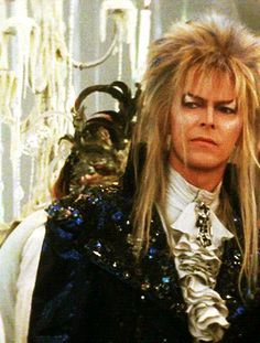 (GIF) Jareth (David Bowie) striding towards Sarah and smiling. #labyrinth #jareth