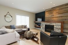 Stan Bailie - Winnipeg, Manitoba, Feature Wall with wood planking and stone fireplace. Living Area, Living Room, Shop Interior Design, Modern Country, Rustic Modern, Country Style, Planking, Table, Furniture