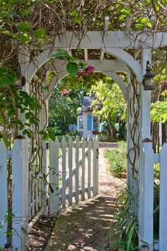 Arch Trellis and gate....House of Turquoise: Margaux Interiors