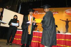 A student with his certificate