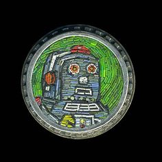 """Cynthia Toops: Tin Toy - Robot, Small round mosaic brooch in polymer micro mosaic. Sterling silver bezel by Chuck Domitrovich. 1 1/8"""" diamet..."""
