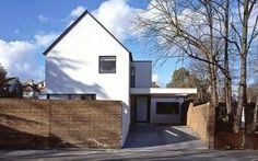 Giving an unattractive house an exterior makeover can add 10 per cent to its value. Ruth Bloomfield meets a couple who transformed theirs. House Window Design, House Design, 1960s House Renovation, Rendered Houses, 1970s House, Arch Building, Home Exterior Makeover, Suburban House, House Extensions