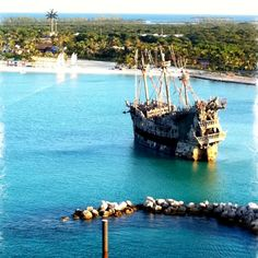 Castaway Cay, Disney's Private Island. This ship from Pirates of the Carribean was docked there while we visited during our cruise! My boys were so excited!