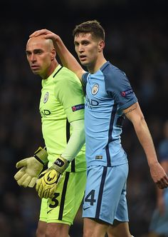 John Stones of Manchester City and goalkeeper Willy Caballero during the UEFA Champions League match between Manchester City FC and FC Barcelona at...