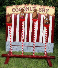 A Coconut Shy with a difference...who could knock those cute faces down!  Perfect village fete wedding game :)