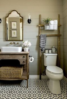 The bathroom echoes the dining room's rustic yet elegant aesthetic with eclectic additions like the framed ...
