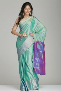 Light Turquoise Green & Purple Soft Silk Saree With Wide Dull Gold Tissue Border & Floral Motifs
